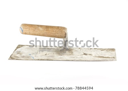 Old dirty trowel isolated on white background - stock photo