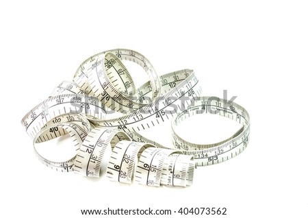 Old dirty white measuring tape roll messy one. - stock photo