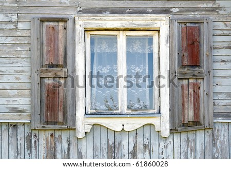 Old dirty white window in the old wooden house texture. The old age concept. - stock photo