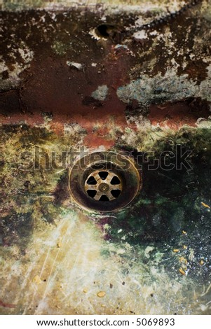 old disgusting dirty colourful drain in ancient industry - stock photo