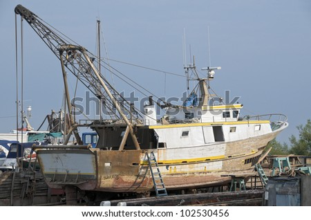Old dockyard with under repair fishing boat