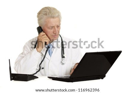 old doctor with a laptop on a white - stock photo
