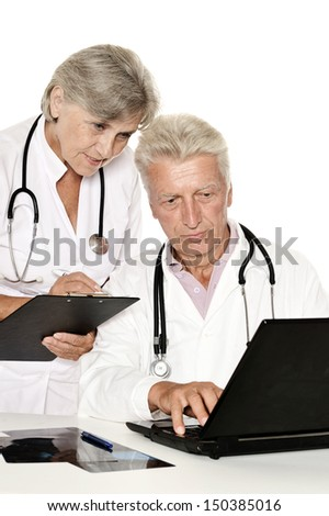 old doctors with a laptop on a white background - stock photo