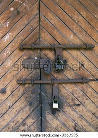 old door and padlocks - stock photo