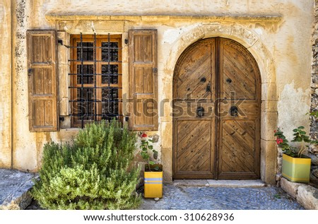 Old door and window. Inside the ruins of Spinalonga.  - stock photo