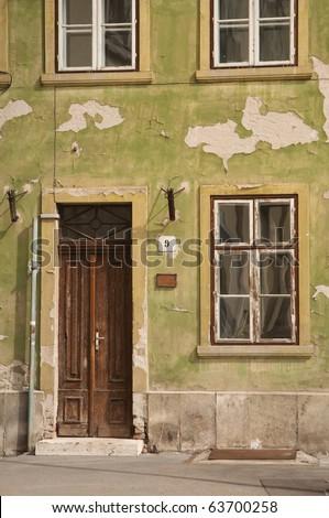 old door and window of green building - stock photo