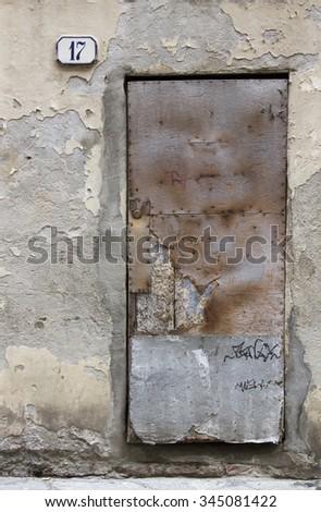 Old door in Lucca, Italy - stock photo