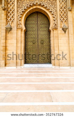 old door in morocco  africa ancien and wall ornate brown - stock photo