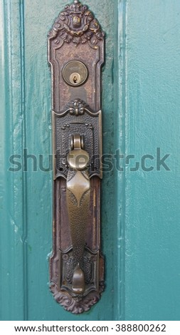 Old Door Knob on Turquoise Painted Wood - stock photo