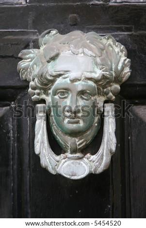 old door knocker - stock photo
