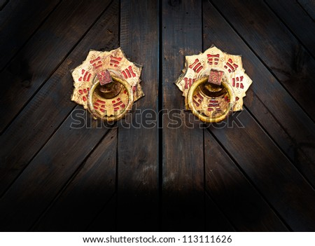 Old door knocker of a garage - stock photo