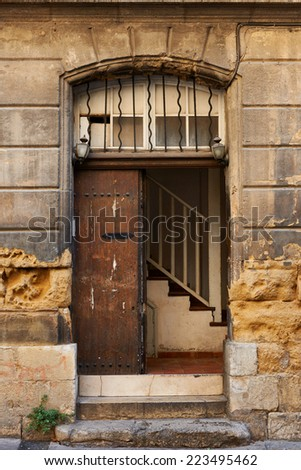 Old door of an ancient building in Aix en Provence town, South France