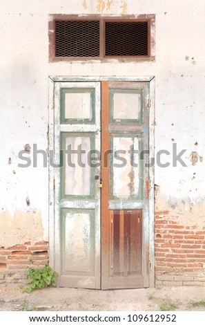 old door on the brick wall - stock photo