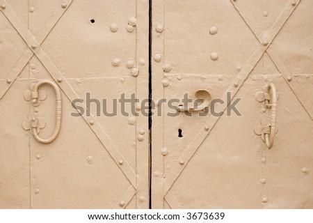 Old door with door handle of church - stock photo