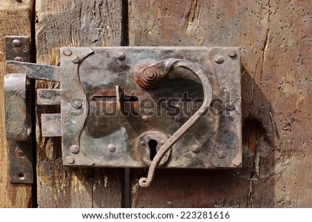 Old Door with Mortise Lock and doorknob. Background and Texture for text or image - stock photo