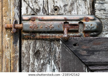 Old door with rusty latch - stock photo