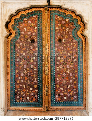Old door with wooden and metal details and colorful patterns ofHawa Mahal (Palace of Winds) built in 1799 in Jaipur, capital of Rajasthan, India - stock photo