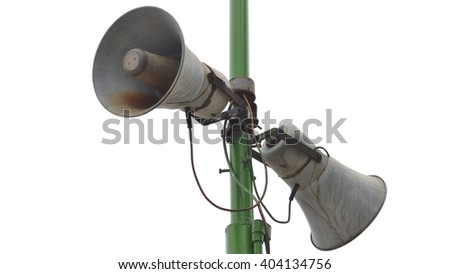 old double loud speaker on a green column - stock photo