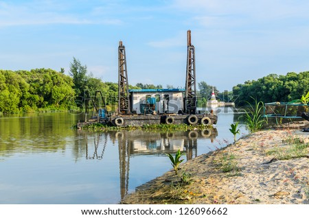 Old dredge sand machine in the river, Thailand - stock photo