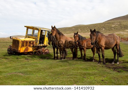 Old dredger and horses - stock photo