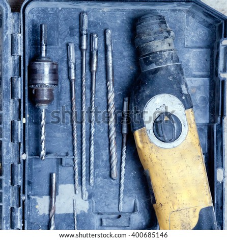 old drill and drill bits are in the box.view from above. - stock photo