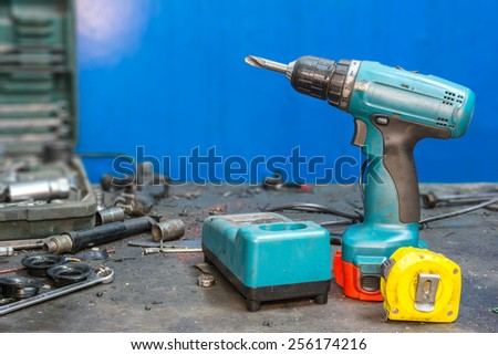 old drill on a blue background - stock photo