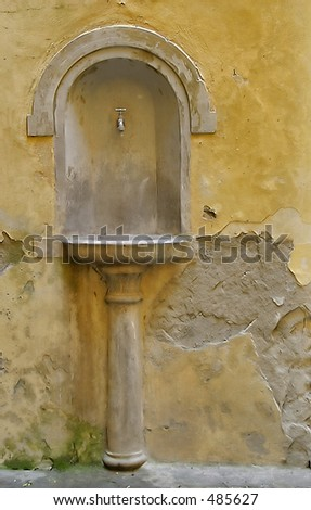 old drinking fountain in Italy - stock photo