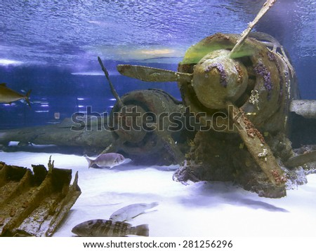 Old drowned vintage aircraft at the bottom of the sea - stock photo