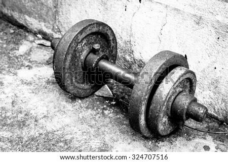 Old dumbbells - black and white - stock photo