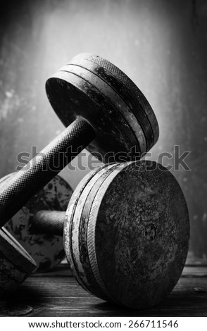 Old  dumbbells, black and white photo  - stock photo