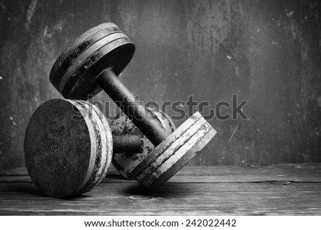 Old  dumbbells, bw photo - stock photo