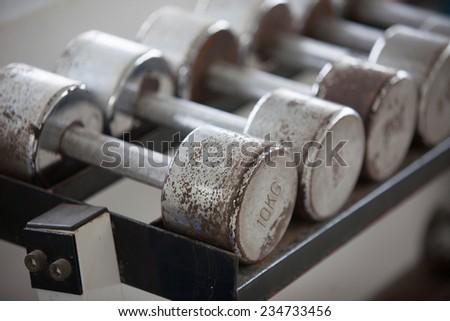 Old dumbbells. Weight Training Equipment - stock photo