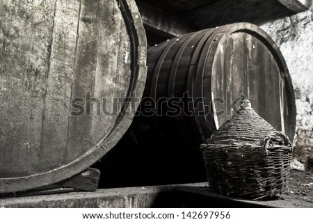 Old dusty and moldy wine cellar - stock photo