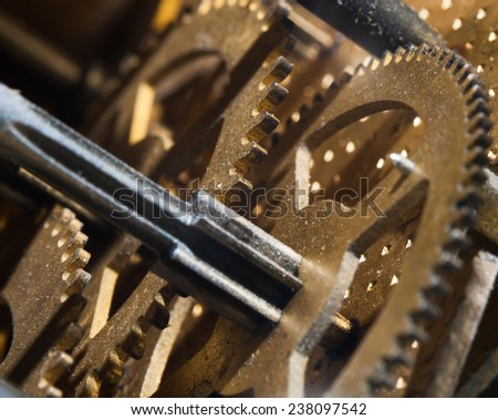 Old dusty clock mechanism closeup - stock photo