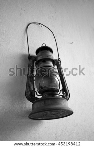 old dusty lantern,museum,age,decoration,lamp, rusty,wall,object,ancient - stock photo