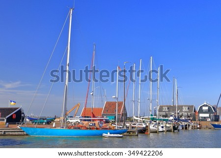 Old Dutch harbor of Marken with traditional sail boats at anchor, Holland
