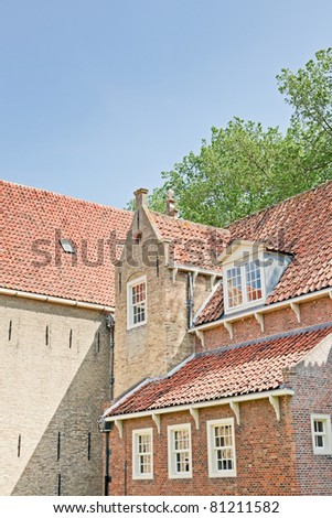 Old dutch houses in old town on hot summer day with blue sky, Enkhuizen, the Netherlands. - stock photo