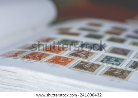 old dutch stamps in album - stock photo