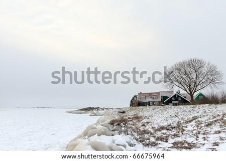 Old Dutch village in winter, Marken, the Netherlands - stock photo