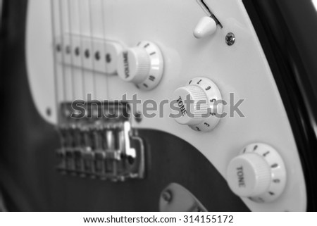 Old electric guitar (black and white picture) - stock photo