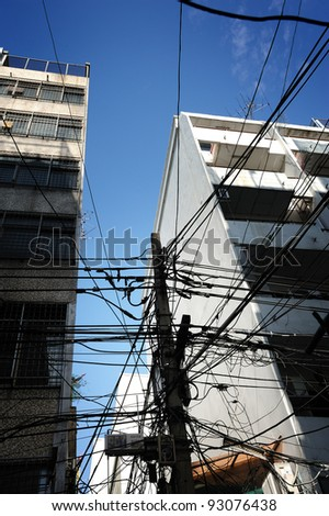 Old electric pillar and cable in Bangkok Chinatown, Thailand.