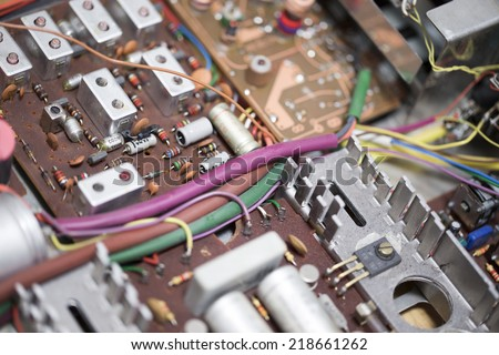 Old electronic circuits - damaged radio - stock photo