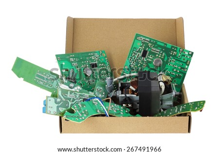 Old electronic printed-circuit boards are prepared for utilization. Standard cardboard packing. Only position designations of elements. Isolated with patch - stock photo
