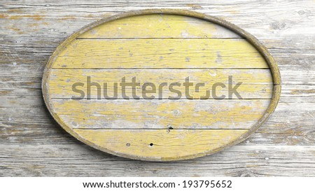 Old elliptic wooden sign on wood wall background - stock photo