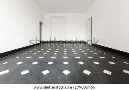 old empty apartment with black marble floors - stock photo