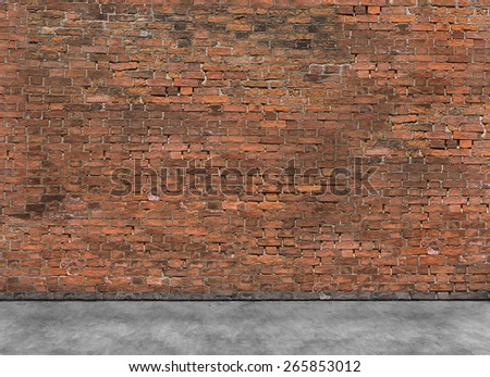 Old empty brick wall with part of foreground  - stock photo