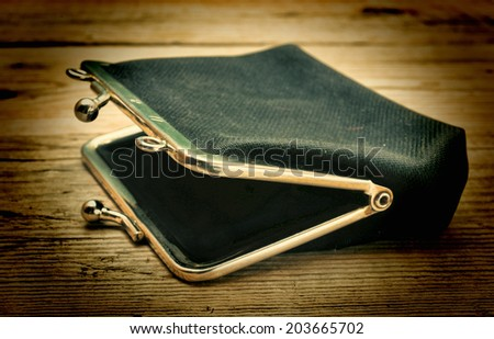 Old empty old purse - stock photo