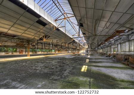 Old empty warehouse - stock photo
