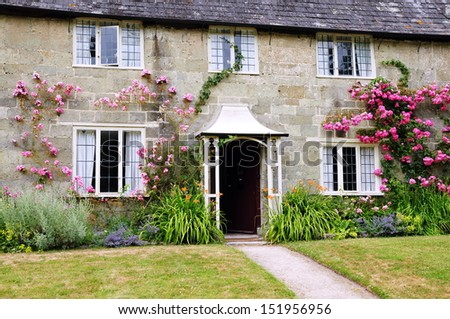 Old English Cottage and Garden - stock photo
