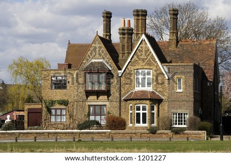 old english house with tall chimneys